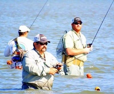 Bay waders massaging Rollover Bay for flounder