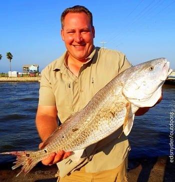 Kingwood TX angler Scott Miller took this nice 28inch slot red on shrimp