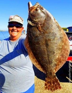 Rollover anglerette Poochie Walker nabbed this nice flatfish on a finger mullet