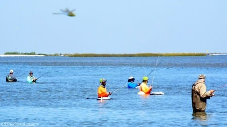 Bay waders fishing for flounder- that's not a helo or plane in the air- but a Skeeter Hawk