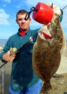 Dayton TX angler Johnny Armstrong shows off his 18 and 21inch flounder he took on mud minnows