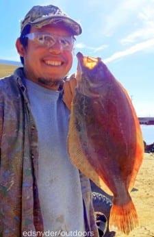 Winnie TX angler Francisco Hernandez took this barely keeper flounder on berkely gulp
