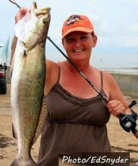 Darlene Keene with a Gator Mouth Trout she caught while wade-fishing
