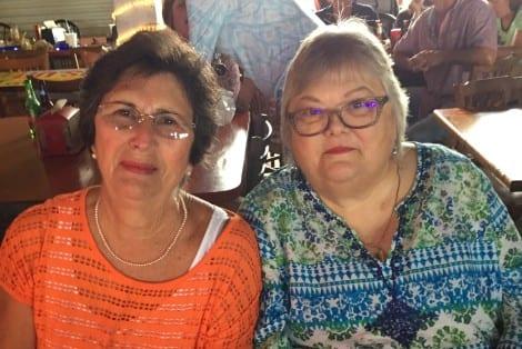 Mary Raney and Beth Rankin share in this joyful celebration.