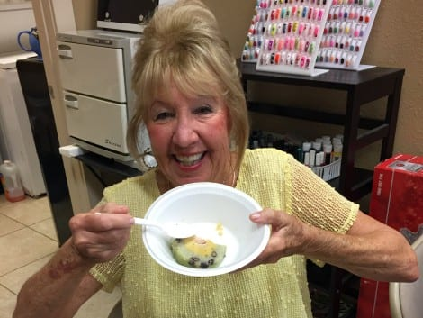 Linda C. Elissalde enjoys a traditional sticky rice, red beans and chicken roll.