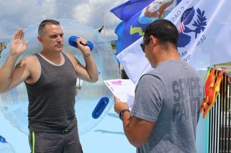 USCG LTJG Mark Velez reading the oath
